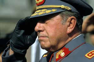 Military Dictator of Chile General Augusto Pinochet stands at attention.