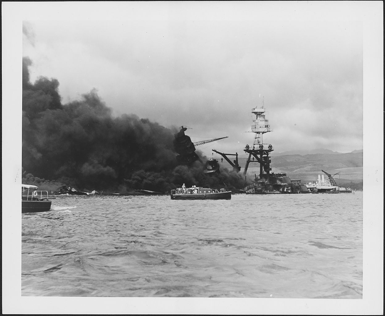 Photograph of the U.S.S. Arizona on fire after the Japanese attack on Pearl Harbor.