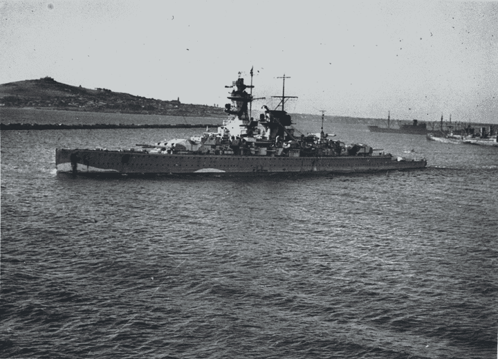Pocket battleship Admiral Graf Spee steaming in the River Plate, South America with shipping in the background.