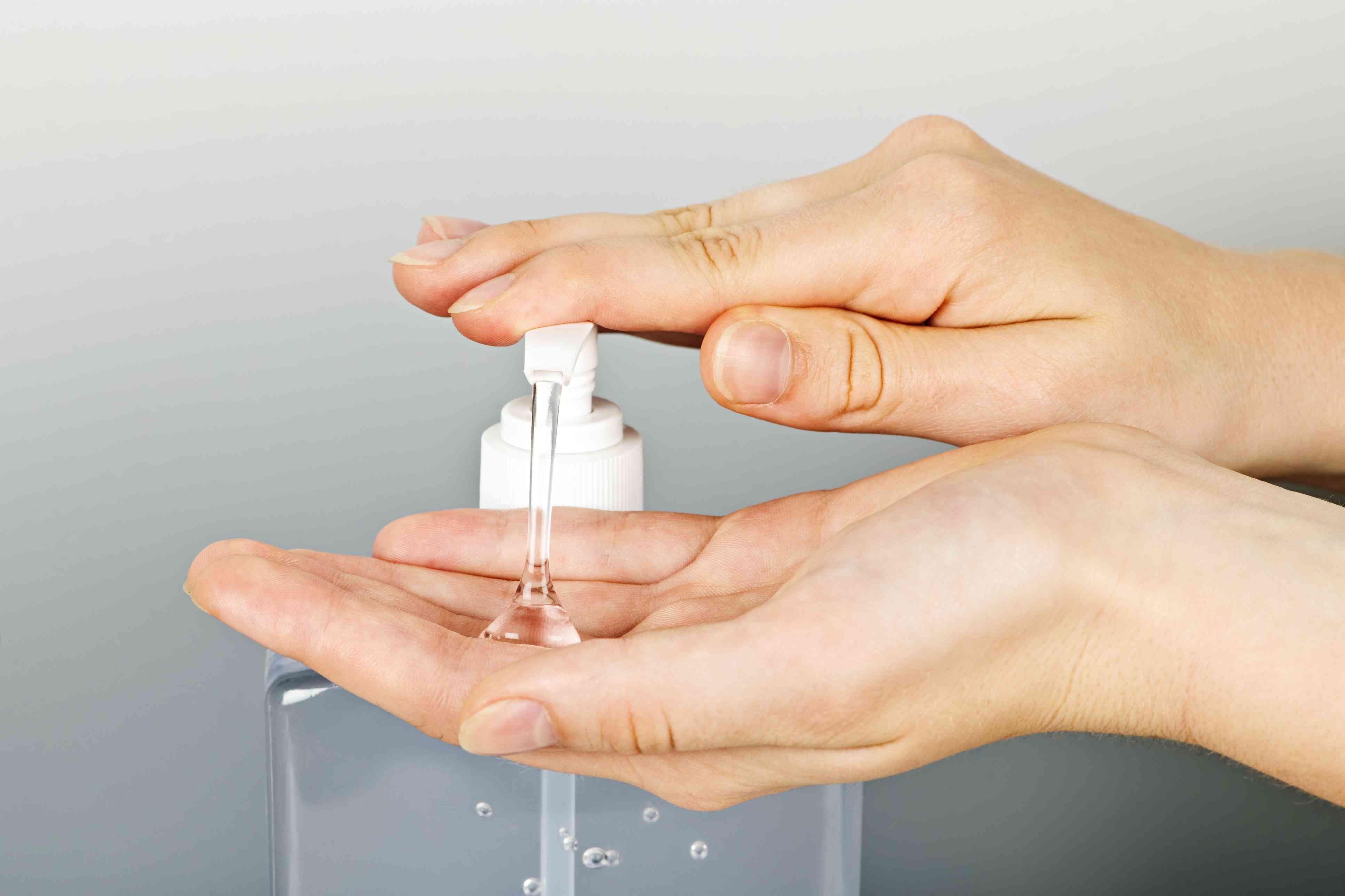Hands applying germ sanitizer gel