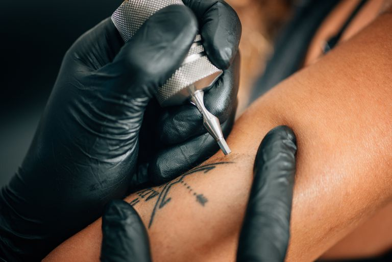Person Tattooing arm