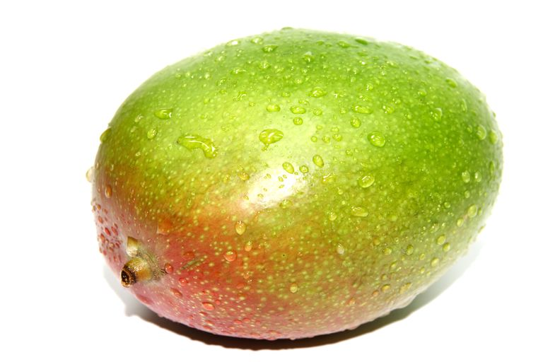 Many people peel a mango and discard the skin, but there are benefits to eating the skin, too.