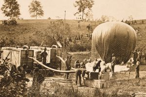 Sepia photograph of Civil War balloon being inflated.