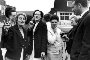 Striking women machinists from the Ford plant at Dagenham are interviewed by a reporter