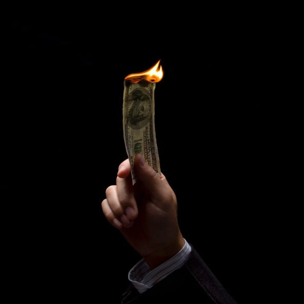 In the burning money demonstration, paper currency is on fire yet is not consumed by the flames.