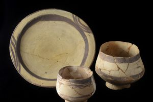 Ubaid Period Pots from Ur against black background.