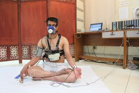 man with breathing mask and various medical wires