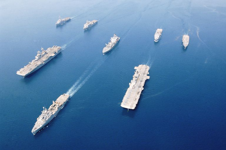 Fleet of military ships at sea in Arabian Gulf, May 2003.