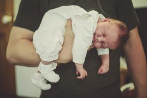 Father holding his newborn baby daughter