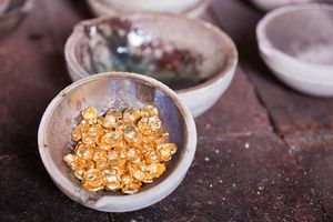 A tiny bowl of gold nuggets