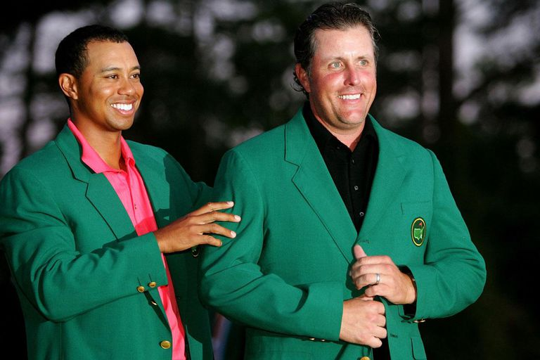 AUGUSTA, GA - APRIL 09: Tiger Woods and Phil Mickelson pose after Woods put the green jacket on Mickelson after winning The Masters at the Augusta National Golf Club after the final round on April 9, 2006 in Augusta, Georgia. Mickelson won with the score seven under.