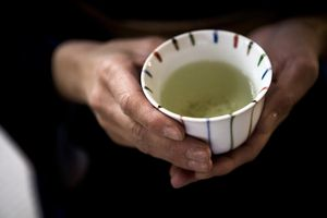 A cup with green tea