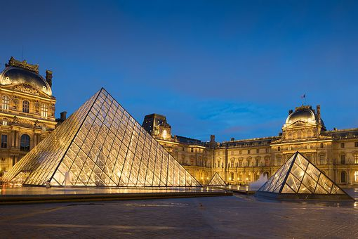 The Louvre Museum and glass pyramids at night