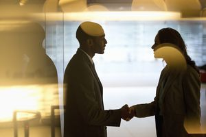 Business people greeting each other in an office