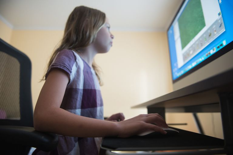 girl programming on a desktop computer