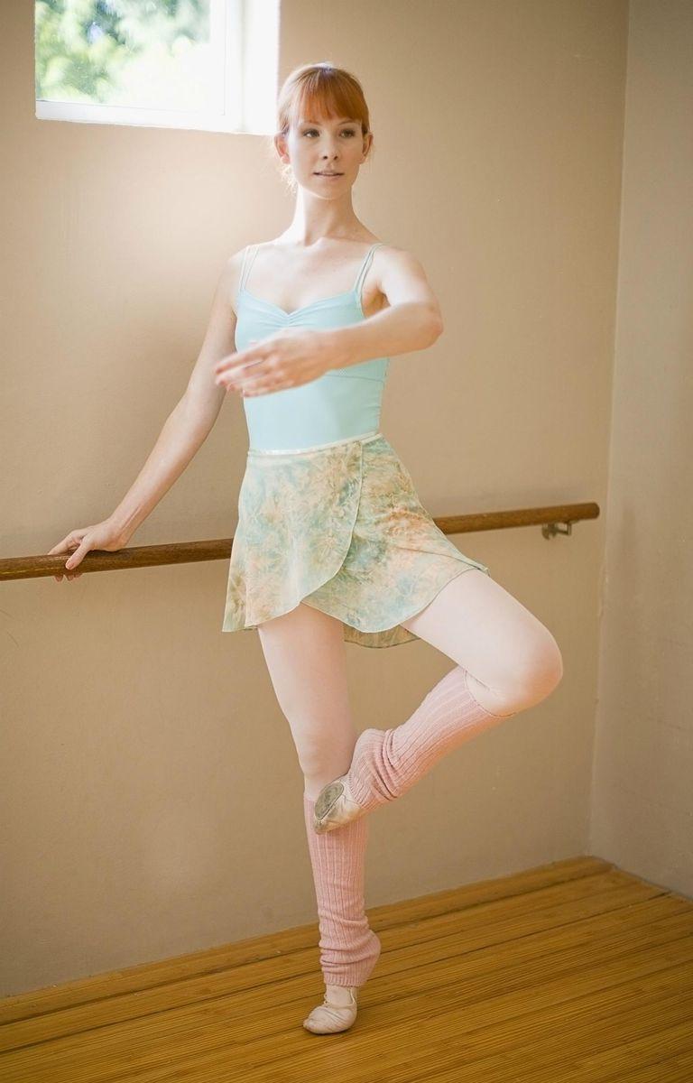 Ballet dancer standing at barre