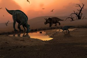 Dinosaurs at a watering hole