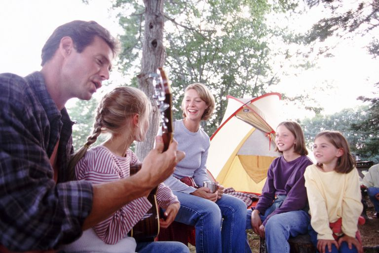 Camping family singing together