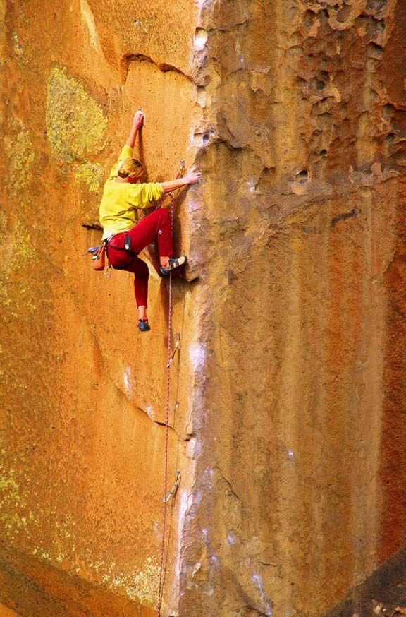 Ian Spencer-Green rock climbing a steep wall