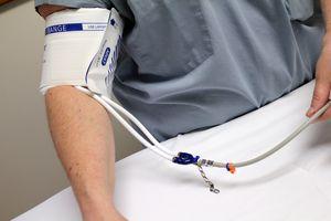 blood pressure cuff on an arm