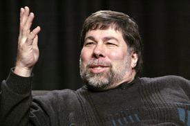 Steve Wozniak sitting in front of a dark background.