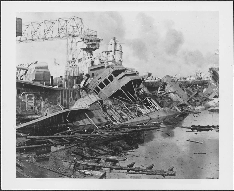 Photograph of warships damaged at Pearl Harbor.
