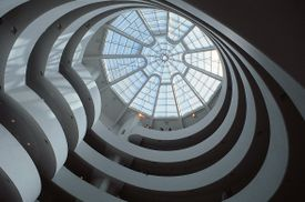 The spiral ramp of the Guggenheim Museum and the glass dome above it.