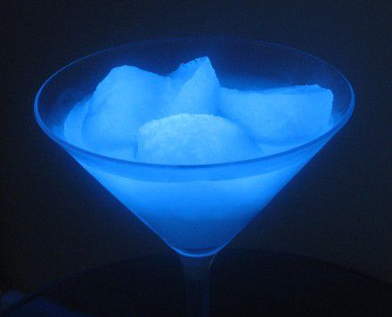 glass with glowing ice and liquid