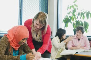 woman teaching adult learner