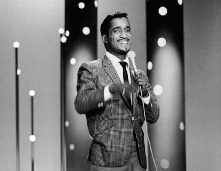 Black and white photograph of Sammy Davis, Jr. performing on stage.