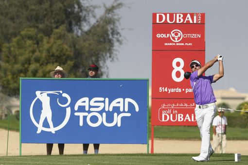 The Asian Tour logo is displayed behind Jbe Kruger as he tees off during a tournament in 2014.