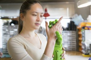 An engineer with a prosthetic hand.