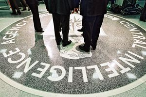 People standing of CIA logo in CIA building