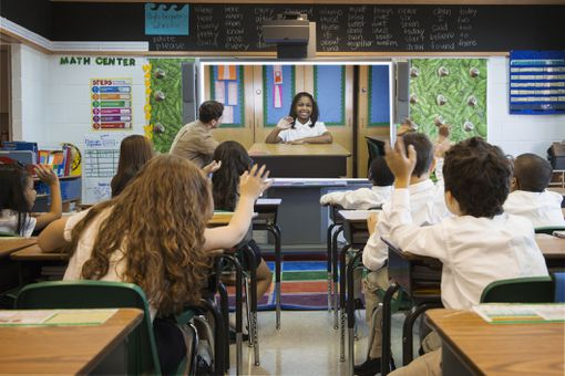Teacher using a projection screen in the classroom.