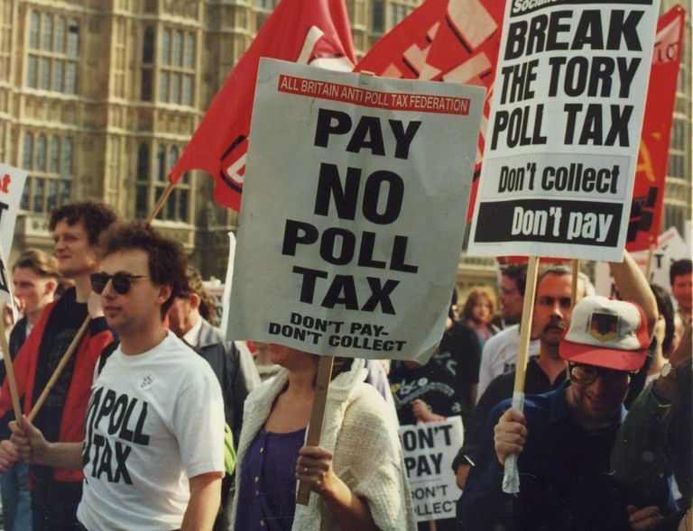 People holding picket signs, marching at Poll Tax protests