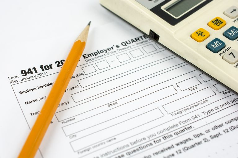 Tax form 941 with pencil and calculator
