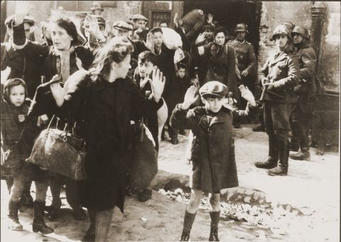 A picture of a young boy and others captured by the SS during the Warsaw Ghetto Uprising.