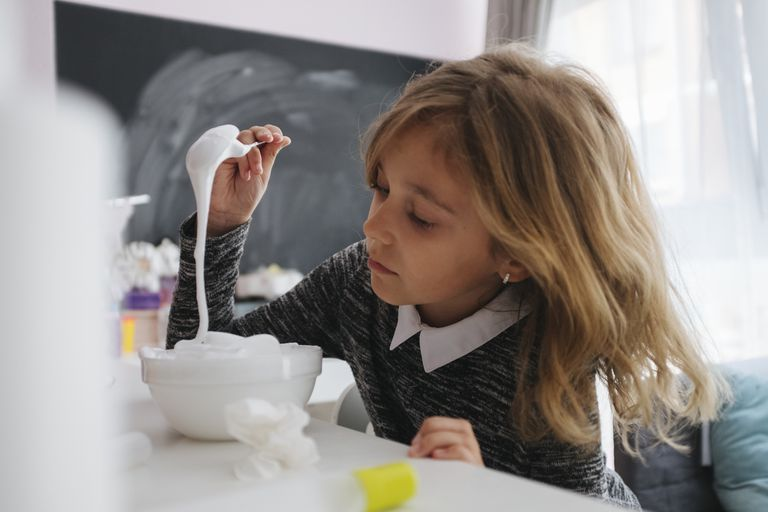 Little girl making slime at home