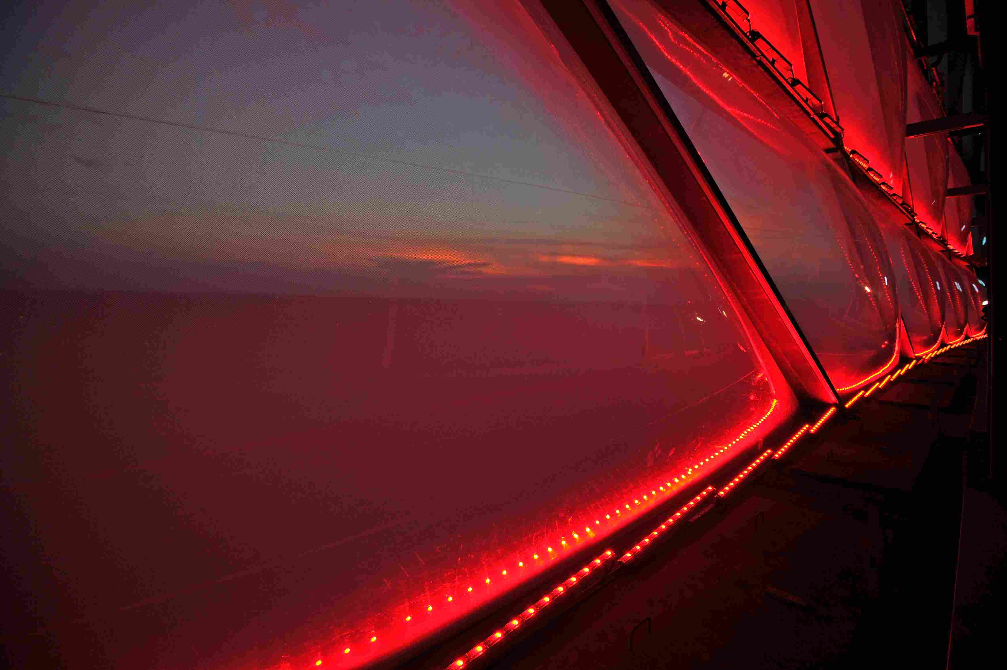 Close-up of small red lights surrounding ETFE plastic panels