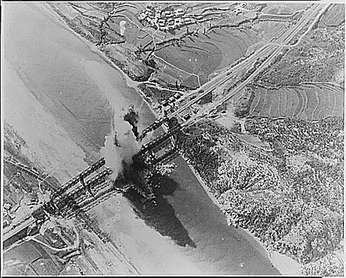 Bombing of the Kum River Bridge near Taejon, South Korea. August 6, 1950.