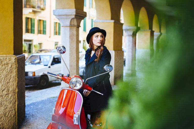 Young woman in Italy with scooter