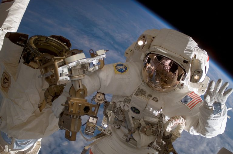 An astronaut performs a spacewalk