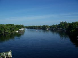 Saint Johns River in Florida stretching into a blue sky.