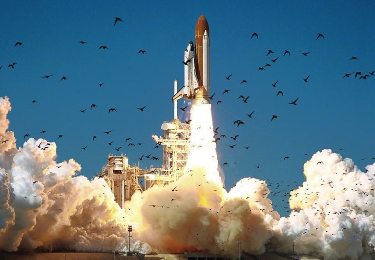 The Space Shuttle Challenger lifting off at the Kennedy Space Center.