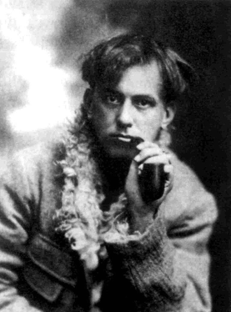 Portrait of Aleister Crowley smoking a pipe.