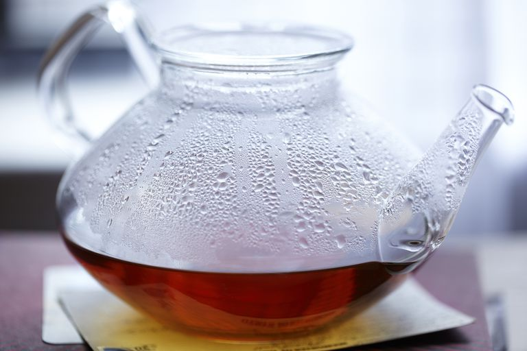 A glass tea pot filled with tea