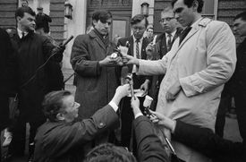 David A. Reed, 19, of Voluntown, Connecticut, David P. O'Brien, 19, of Boston, David Benson, 18, of Morgantown, Virginia and John A. Phillips, 22, of Boston as they burn their draft cards at a Vietnam War protest in Boston