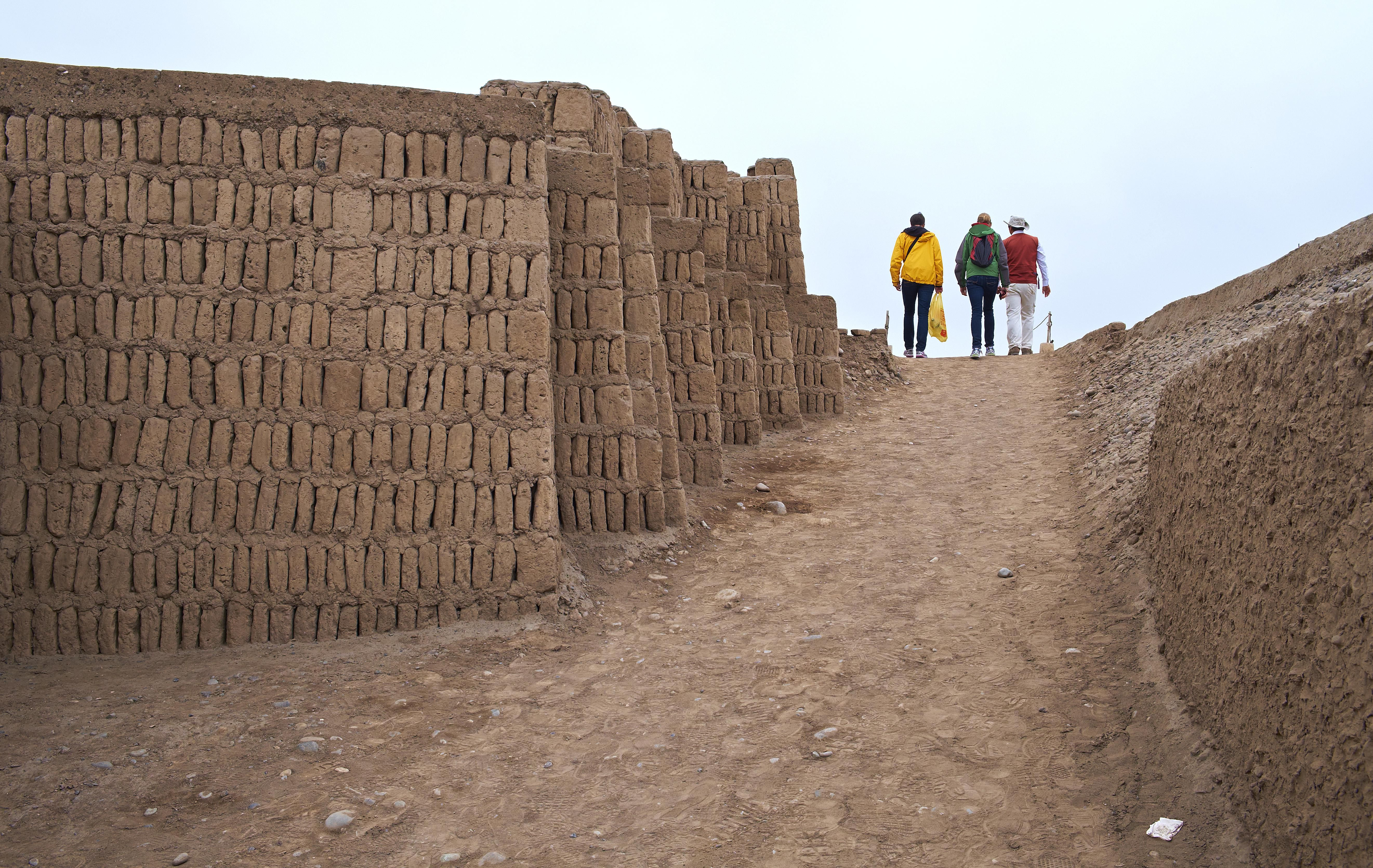 People walking along Huaca Pucllana ruins.
