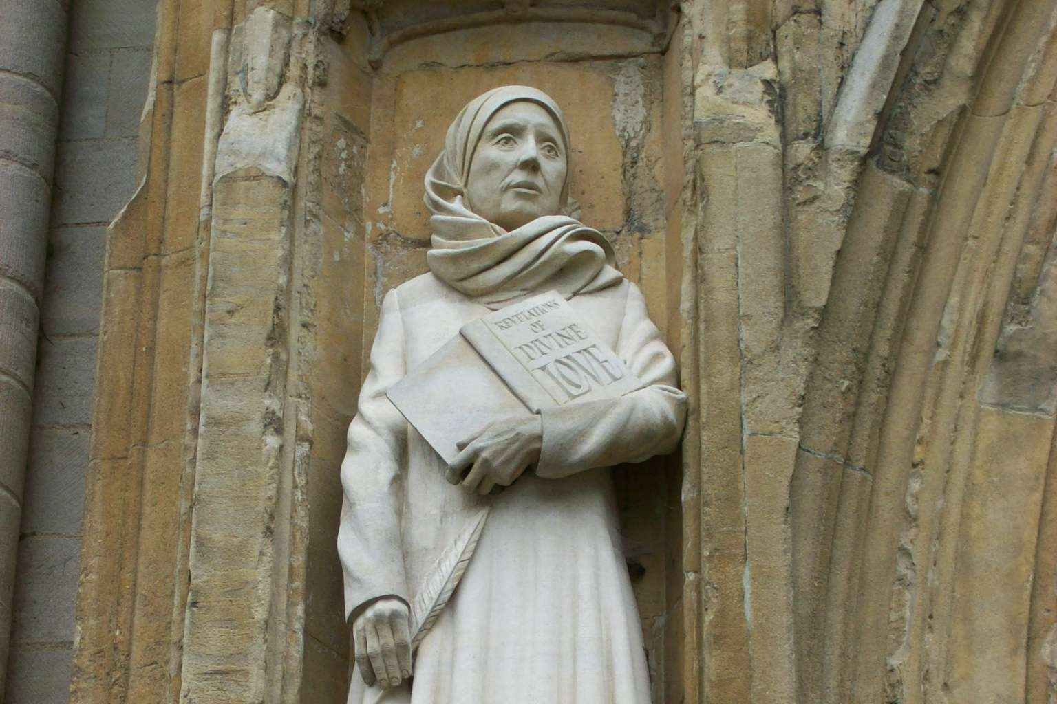 Statue of Julian of Norwich by David Holgate, west front, Norwich Cathedral