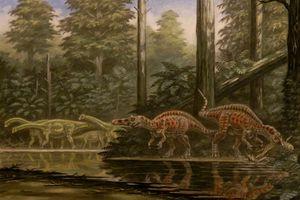 Drawing of dinosaurs around a lake.